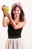 Portrait of attractive young caucasian woman showing green grapes Royalty Free Stock Images
