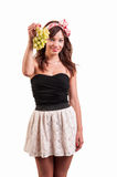 Portrait of attractive young caucasian woman showing green grapes Stock Images