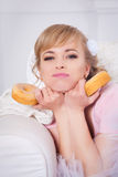 Portrait of attractive young charming woman with donuts Stock Image