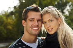 Portrait of attractive young couple. In park, smiling Royalty Free Stock Images