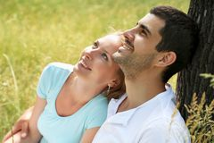 Portrait of attractive young couple in love outdoors. Royalty Free Stock Photos