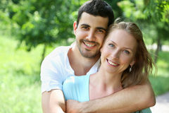 Portrait of attractive young couple in love outdoors. Close up portrait of attractive young couple in love outdoors Royalty Free Stock Photography
