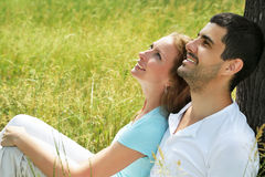 Portrait of attractive young couple in love outdoors. Close up portrait of attractive young couple in love outdoors Royalty Free Stock Photo