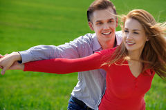 Portrait of attractive young couple in love outdoors. Royalty Free Stock Images