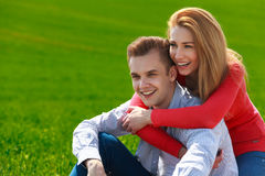 Portrait of attractive young couple in love outdoors. Stock Photos