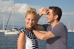 Portrait of attractive young couple in love on sailing boat. Happy handsome couple posing on sailing boat Stock Photography
