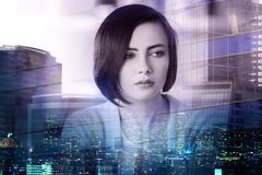 Employment and think concept. Portrait of attractive young european woman on abstract city background. Employment and think concept. Double exposure Royalty Free Stock Image