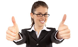 Portrait of attractive young female student showing a thumbs up Stock Image