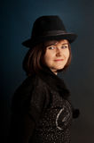 Portrait of attractive young girl in hat. Royalty Free Stock Image