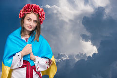 Portrait of attractive young girl in national dress with Ukraini Stock Image
