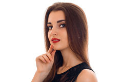 Portrait of an attractive young girl with red lipstick that looks into the camera isolated on white background Stock Image