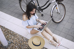 Portrait of attractive young girl using laptop Royalty Free Stock Image