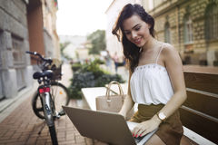 Portrait of attractive young girl using laptop Stock Photos