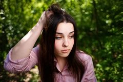 Portrait of attractive young hesitant perplexed woman face clos stock photos
