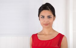 Portrait of attractive young indian woman in red. Royalty Free Stock Photo