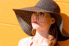 Portrait of attractive young lady wearing black straw hat Royalty Free Stock Image