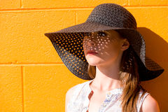 Portrait of attractive young lady wearing black straw hat Stock Photo
