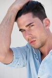 Portrait of an attractive young man with hand in hair Royalty Free Stock Photo