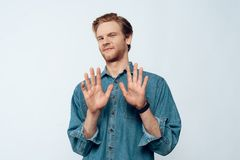 Portrait of Attractive Young Man Hands Up. Handsome Serious Bearded Pensive Man Saying No and has Failure Reaction. Isolated on white background. Concept of stock photo