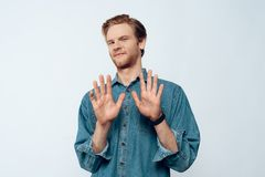 Portrait of Attractive Young Man Hands Up royalty free stock photos