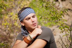 Portrait of an attractive young man on nature Stock Images