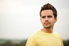 Portrait of attractive young man outdoors. Portrait of a young man looking confidently ahead royalty free stock image