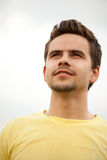 Portrait of attractive young man outdoors. Portrait of a young man looking happily ahead stock images