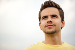Portrait of attractive young man outdoors. Portrait of a young man looking happily ahead royalty free stock photo