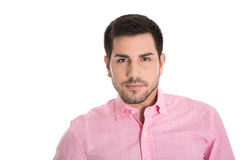 Portrait of attractive young man in a pink shirt isolated on whi Stock Images