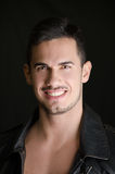 Portrait of attractive young man shirtless with leather jacket Royalty Free Stock Images