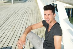Portrait of an attractive young man smiling outdoors Stock Images