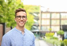 Portrait of attractive young man in stylish outfit. Outdoors stock photos