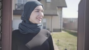 Portrait of beautiful young muslim woman enjoying spring weather on the street wearing traditional headscarf. Close up. Portrait of attractive young muslim woman stock video
