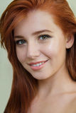 Portrait of an attractive young redhead with clean fresh skin on Royalty Free Stock Image