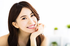 Portrait of attractive young smiling woman Royalty Free Stock Images