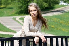 Portrait of an attractive young woman. Young woman on outdoor background Stock Photography