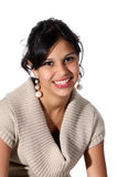 Portrait of attractive young woman. Portrait of cute young Hispanic woman wearing a beige sweater with her long black hair up Royalty Free Stock Images