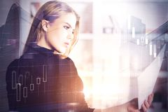Market and economy concept. Portrait of attractive young woman with document in hand on abstract city background with sunlight and forex diagram. Market and Royalty Free Stock Images
