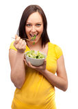 Portrait of an attractive young woman eating salad Stock Image