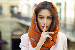 Portrait of attractive young woman with finger on lips. Portrait of attractive brunette woman with finger on lips, concept of student show quiet, silence, secret Stock Photos