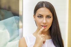 Portrait of attractive young woman with finger on lips. Portrait of attractive girl with finger on lips, concept of student show quiet, silence, secret gesture Royalty Free Stock Images