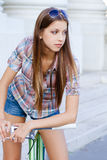 Portrait of an attractive young woman with fixie b Royalty Free Stock Photography
