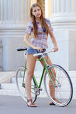 Portrait of an attractive young woman with fixie b Stock Image