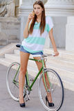 Portrait of an attractive young woman with fixie b Royalty Free Stock Photo