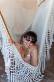 Portrait of an attractive young woman in a hammock Royalty Free Stock Photography