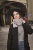 Portrait of attractive young woman in hat. At the street Royalty Free Stock Images