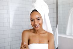 Portrait of an attractive young woman in her bathroom royalty free stock photos