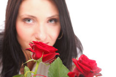 Portrait attractive young woman holding a red rose Stock Images