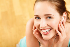 Portrait of attractive young woman listening to music at gym Stock Photo