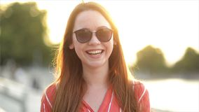 Portrait Of An Attractive Young Woman Looking Right at Camera Smiling And Laughing. Close Up View of Girl with Caucasian stock footage